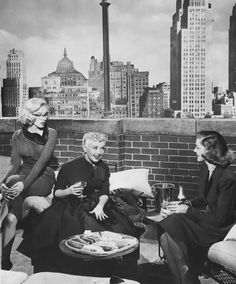 """Marilyn Monroe, Betty Grable, and Lauren Bacall along with their rather incredible view of Manhattan in """"How to Marry a Millionaire."""""""