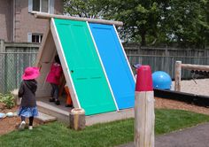 recycled door playhouse by earthscape playground DIY1