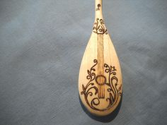 Guitar Wooden Spoon with wood burning pyrography by notjustknots on Etsy