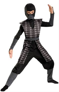 Boys Evil Ninja Costume - Your boy will be looking deadly this Halloween with this Evil Ninja costume. This two-piece costume includes a mask and jumpsuit. The mask is made of stretchy black fabric, and is pulled over the head. It features a detachable mouthpiece which connects to the mask via velcro. The jumpsuit is also made of stretchy black fabric. It features a foam padded tunic and apron, which is detailed with a scale-mail-look design. #ninja #kids #costume #yyc #calgary