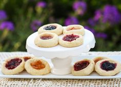 Josie's Jelly Cookies are tender vanilla shortbread cookies filled with your favorite flavor of jam or jelly. The jewel-toned center makes these an elegant, beautiful addition to any table. Recipe shared with permission granted by Catherine Bruns, author BAKED TO DEATH, A Cookies & Chance Mystery. For the full recipe please visit http://cinnamonsugarandalittlebitofmurder.com/2016/03/josies-jelly-cookies/