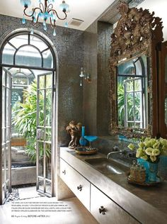 Arched door to outdoor space from bathroom