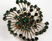 Emerald is for May! A fantastic Etsy treasury by JewlsinBloom that features our Emerald Green brooch! Double click through to see all the gorgeous emerald green vintage items!
