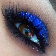 Starry night eye makeup. Bright blue eyeshadow. Black eyeshadow and eyeliner along the lash line and a lot of mascara. Looks really good with brown eyes