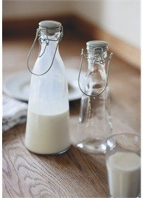 Stylish vintage glass milk bottle with Flint ceramic lid from Garden Trading