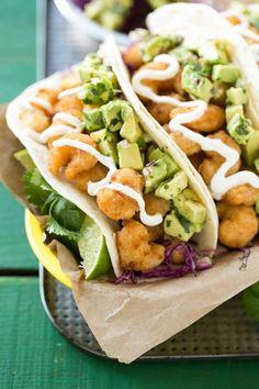 This recipe forfried shrimp tacosis a pile of crispy shrimp, cilantro lime cabbage slaw & avocado relish that's stuffed inside warm flour tortillas.