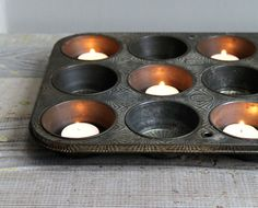 Vintage muffin tin as tealight holder: I like the idea of this on a kitchen island during a party.