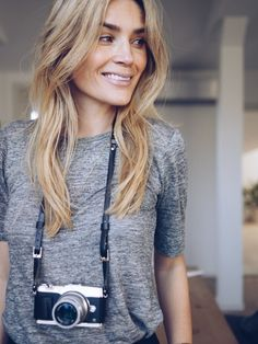 Camilla Pihl - grey tshirt and leather camera strap.