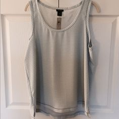 Ann Taylor Sleeveless Top Women's large, sleeveless top. Loose fitting. Item comes from a smoke free and pet free home. Ann Taylor Tops Blouses
