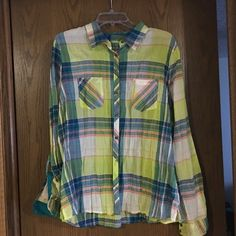 NWOT multicolored plaid button up Never worn! Great for casual wear, came in the wrinkly style but im sure you can iron it! Maurices Tops Button Down Shirts