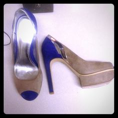 Calvin Klein heels Brand new Calvin Klein heels never used or worn . Only tried on . Sliver grey and cobalt blue Calvin Klein Shoes Heels