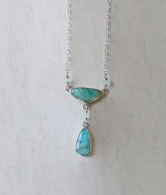 This pleasing and enticing necklace features gorgeous multi-color Peruvian Opals as its centerpiece. Peruvian opal attached pendant has another opal hanging with a chalcedony bead. The sterling silver