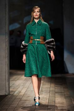 Prada Fall 2013 - Harpers Bazaar      Green wool skirt suit with fur-trimmed cuffs. Check out Harper's Bazaar's descriptions for Prada 2013 in images 1-7.