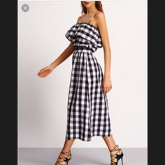 "Black and White plaid off the shoulder dress Adorable dress but it's tight in the rib cage for me.  Says size L but I think it fits more like a M.  Side zip.  I am 5'3"" and the length is fine for me.  No tags or label but it's brand new. Dresses"