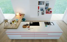 Worktop in laminate tuttocolore bianco thickness 20 mm and natural oak thickness 80 mm.