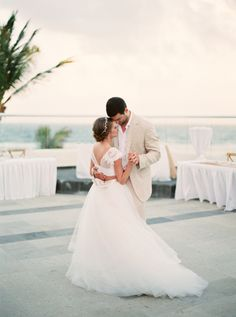Gorgeous #EnzoaniRealBride Emily in her custom crop top Enzoani gown | Style Me Pretty