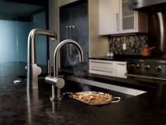 When you want steaming hot water for your afternoon tea, for boiling pasta, or for thawing frozen veggies—but don't want to wait to heat it up—an instant-hot-water dispenser is perfect. It delivers piping-hot water at your kitchen sink by simply moving a handle.   The water dispenser is located above the sink, so you'll need a hole for the faucet. You can replace a sprayer or soap dispenser or make a new hole. The hot-water tank connects to the water supply line and is installed under t