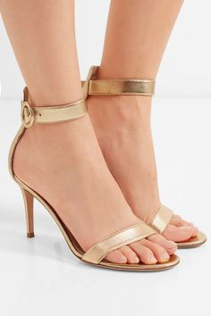 Gianvito Rossi's signature 'Portofino' sandals have been hand-finished in Italy. Made from gold leather, they have a supportive panel at the heel, two elegant straps and a chic circular buckle. The lightly cushioned insoles and manageable 85mm height will make long hours on your feet and late-night events feel easy. x