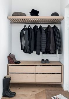 This is what l want to do as my wardrobe, just with more feminine touches.. maybe white wood chests