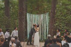 Really want a 'ribbon wall' for the ceremony decor...just tie ribbon to a string and tie on trees or some kind of structure. If it is breezy, it will create a whimsical feeling