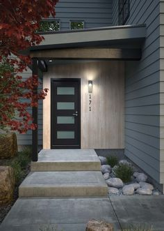 The Quadrate modern outdoor wall sconce light by LBL Lighting generates an uplight to nicely graze architectural wall surfaces. The downlight accents the extended backplate, while the clean, modern LED lighting design is elegantly simple yet very impac Modern Exterior Doors, Modern Front Door, Exterior House Colors, Exterior Design, Modern Exterior Lighting, Modern Garage Doors, Barn Garage, Modern Home Exteriors, Modern Front Porches