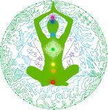 Yoga pose and chakras green mandala Stock Photo