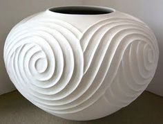 I can't find the name of the artist. beautiful vessel covered in curly texture. pottery ceramics clay