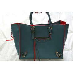 Teal T O T E Faux leather. Blue with some red out lining. Top zipper closure. Removable shoulder strap. It has. Zipper to expand if desired. Additional organizer bag (leopard print).                          Now you can visit my blog @ livinlavidamari.com Bags Totes