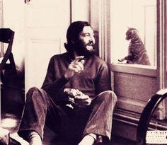 Julio Cortazar y un gato perdido en la rayuela,,