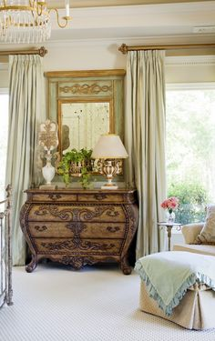 love the antique mirror above the commode