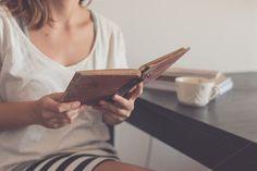 Young woman reading an old book by Seronda Estudio on Creative Market