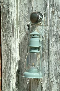 Distressed door .. Timeless beauty . & totally loving the color of the lantern ..