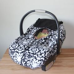 The cutest car seat covers ever! Never use a bunting or coat on a baby- it is not safe. Here is a safe alternative.    Winter Infant Car Seat Cover  Black and White by dancecoach4eva, $34.00