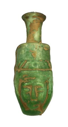 Sadigh Gallery's Ancient Egyptian Green Glass Hathor Flask by SadighGallery, via Flickr