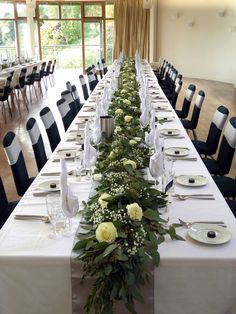 Table garland of mixed foliage with roses and gypsophila
