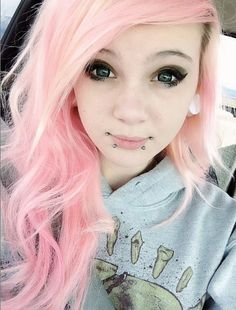 Hate pink, but she pulls this pastel pink hair off well and I love the piercings