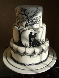 Natalie Madison's Artisan Cakes - Little Rock Arkansas Cakes, a handpainted bride and groom scene with black pearl borders and scalloped chandelier work.