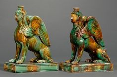 Pair of Wedgwood Majolica Sphinx Candlesticks, England, c. 1867, each polychrome decorated and modeled seated on a raised rectangular base.