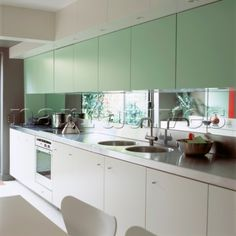 Modern kitchen units with mirrored splashback