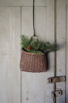 old basket stuffed with pine. use basket in garage Primitive Christmas, Country Christmas, Simple Christmas, Winter Christmas, Winter Holidays, All Things Christmas, Christmas Home, Vintage Christmas, Merry Christmas