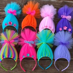 ALL items from this shop are made in a smoke-free, pet-free environment. Long pieces of tulle wrapped around a 3/8 hard grosgrain ribbon wrapped headband to resemble troll hair. Headband height measures about 8 inches. Includes a tulle bow to secure the hair together. Price is for ONE