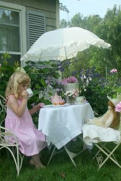 little girl's tea party with her teddy bear on a warm summer day :) can't wait to do this with my daughters
