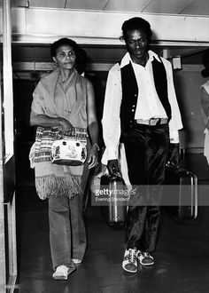 Rock 'n' roll legend, singer, songwriter and guitarist Chuck Berry arrives at Heathrow Airport with his wife Thematta.