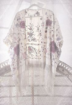 Love this sheer white purple floral kimono. Perfect for the upcoming warm weather
