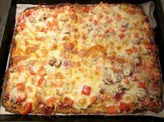 Pizza met bloemkoolbodem. Lijkt mij heerlijk met geitenkaas.