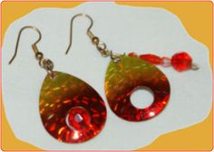 http://diginanchors.com/EarringsAlure_DangleRockyRed - Dangling earrings made from a fishing lure with blended red and gold colors with hole in the blade to cause vibrations. The beauty of the colors and style may cause vibrations in the heart of the viewer. All EarringsAlure earrings are handmade using crystal elements and sparkling beads with surgical stainless steel earwires or clips. Comes in four colors and two sizes.