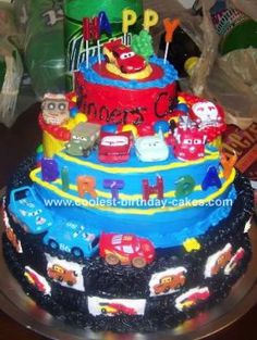 Cars Cake: With the designing help of my husband and mom we came up with a really cool concept for my daughters third birthday Cars cake. I used, I think it was,