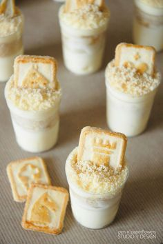 Mini Banana Pudding Dessert Shooters (yields 40) 1   12-oz container frozen whipped topping, thawed 1   14-oz can sweetened condensed milk 1   8-oz package cream cheese, softened 2 cups milk 1   5-ounce box instant Vanilla pudding 3   bananas, sliced 1   bag Pepperidge Farm Chessmen cookies - crushed into crumbs 2-3 bags Pepperidge Farm MINI Chessmen cookies