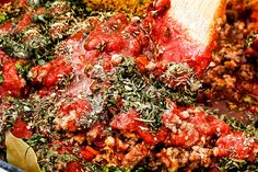 showing how to make authentic bolognese sauce by adding parsley, thyme, oregano, basil, crushed tomatoes to a pot Easy Spaghetti Bolognese, Spaghetti Sauce, Spagetti, Best Bolognese Sauce, Bolognese Recipe, Sauce Recipes, Pasta Recipes, Great Recipes, Favorite Recipes