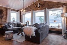 Gray upholstery cools down warm walls with creamy curtains. Small Lake Cabins, Country Girl Home, Norway House, Log Home Interiors, Living Spaces, Living Room, Room Additions, Cottage Design, Log Homes